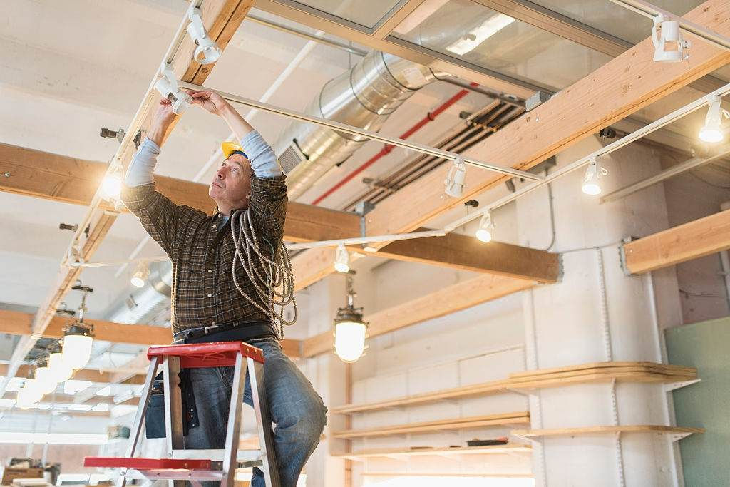 electrician installing track lighting